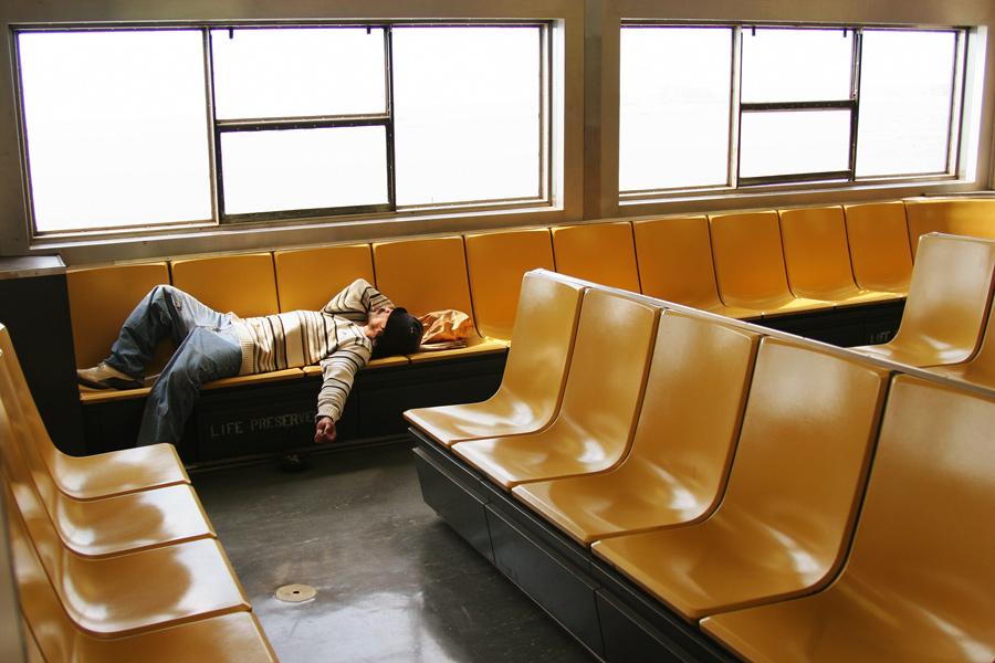 A Man Asleep on the Staten Island Ferry