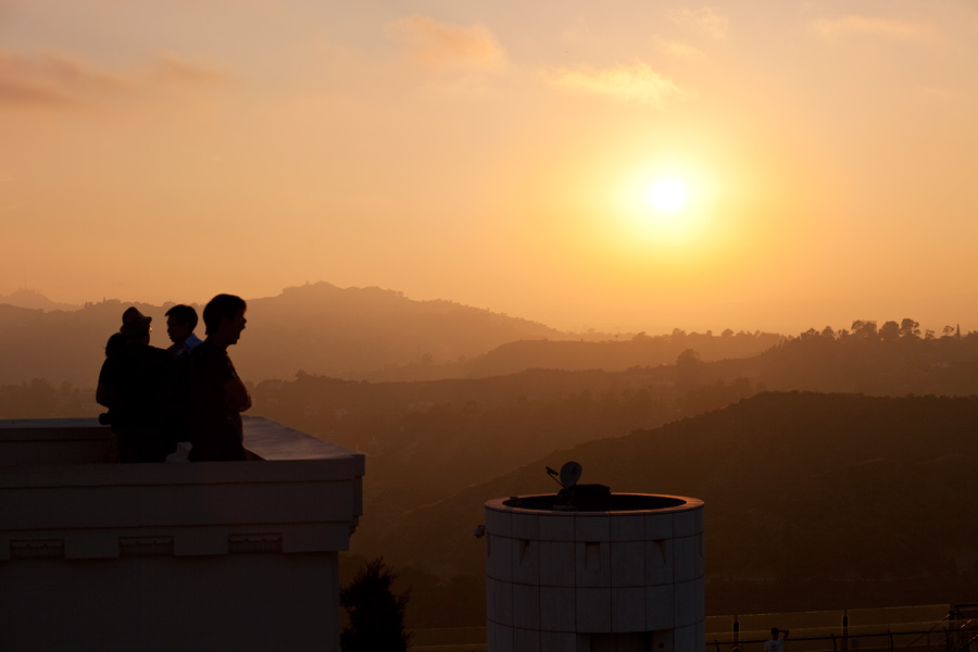 A man yawning on the roof of the Griffith Observatory in Los Angeles